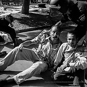 """Roundup and detention of African immigrants who were in the Plaza André Malraux and whose crime was to be """"without papers"""". Barcelona, Spain."""
