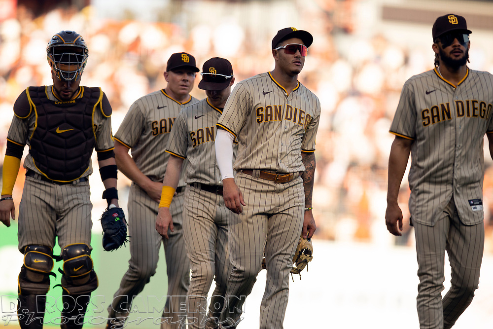 San Diego Padres players celebrate their 10-inning 3-2 victory over the San Francisco Giants in a baseball game, Saturday, Oct. 2, 2021, in San Francisco. (AP Photo/D. Ross Cameron)
