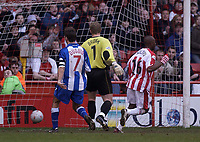 Photo. Glyn Thomas.<br /> Sheffield United v Colchester. FA Cup fifth round.<br /> Bramall Lane, Sheffield. 15/02/2004.<br /> Colchester's Karl Duguid (L) and Simon Brown look on in horror and Sheffield's Peter Ndolvu (R) wheels away in delight after Paul Peschisolido put the home side a goal up.