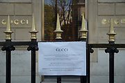 """March, 27th 2020 - Paris, Ile-de-France, France: Paris under confinement, Gucci,Avenue Montaigne area of high fashion, beauty, accessories, haute couture, all shops closed, in 8th arrondissement, and all public spaces virtually empty to stop the spread of the Coronavirus, during the eleventh day of near total lockdown imposed in France. The President of France, Emmanuel Macron, said the citizens must stay at home for at least 15 days, that has been extended. He said """"We are at war, a public health war, certainly but we are at war, against an invisible and elusive enemy"""". All journeys outside the home unless justified for essential professional or health reasons are outlawed. Anyone flouting the new regulations is fined. Nigel Dickinson"""