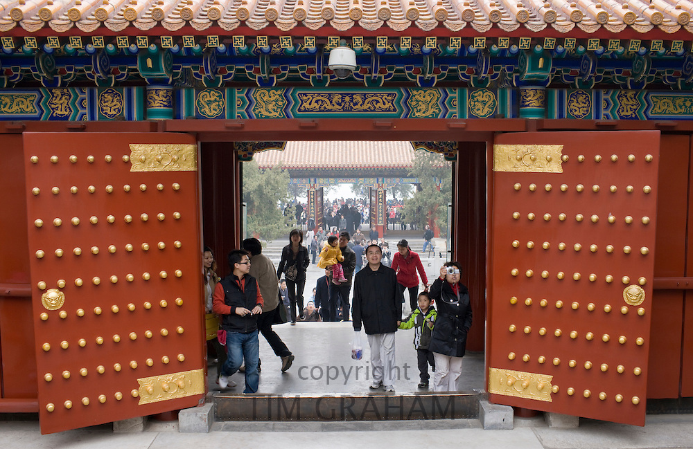Tourists stand at gates to Tower of Buddhist Incense at The Summer Palace, Beijing, China