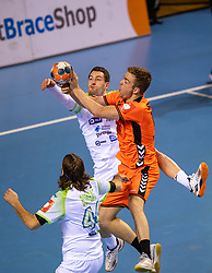 11-04-2019 NED: Netherlands - Slovenia, Almere<br /> Third match 2020 men European Championship Qualifiers in Topsportcentrum in Almere. Slovenia win 26-27 / Miha Zarabec #23 of Slovenia, Bobby Schagen #14 of Netherlands
