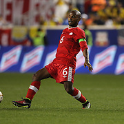 Julian DeGuzman, Canada, in action during the Columbia Vs Canada friendly international football match at Red Bull Arena, Harrison, New Jersey. USA. 14th October 2014. Photo Tim Clayton
