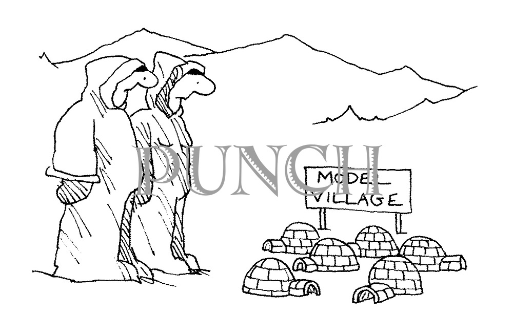 (Two Eskimos look at some miniature igloos beneath a sign reading 'Model Village')