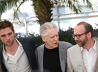 Robert Pattinson, David Cronenberg, Paul Giamatti,  Cosmopolis photocall at the 65th Cannes Film Festival France. Cosmopolis is directed by David Cronenberg and based on the book by writer Don Dellilo.  Friday 25th May 2012 in Cannes Film Festival, France.