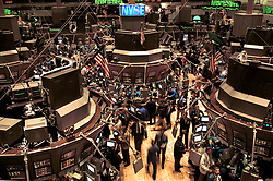 Traders are busy at work on the floor of the New York Stock Exchange. (Photo © Jock Fistick)