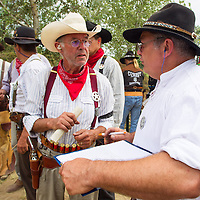 Judges evaluate results of a participant during the Cowboy Action Shooting European Championship in Dabas, Hungary on August 11, 2012. ATTILA VOLGYI