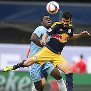 Felipe Martins, (right), New York Red Bulls, is challenged by Kwadwo Poku, NYCFC, during the New York City FC Vs New York Red Bulls, MSL regular season football match at Yankee Stadium, The Bronx, New York,  USA. 28th June 2015. Photo Tim Clayton