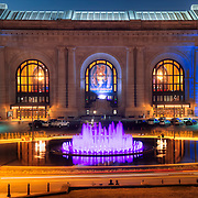 Kansas City Union Station at dusk with recently renovated Bloch Memorial Fountain with new LED lighting