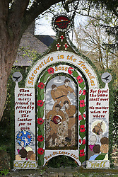 © Licensed to London News Pictures. 05/05/2016. Tissington, UK. One of six colourful dressed wells in the Derbyshire village of Tissington. The origins of well dressing may have pagan roots later given a Christian Meaning. The dressings are made of clay dug locally which is adorned with dried flowers. The dressings are erected on the eve of Ascension day ready for the ceremony of blessing. Photo credit : Ian Hinchliffe/LNP