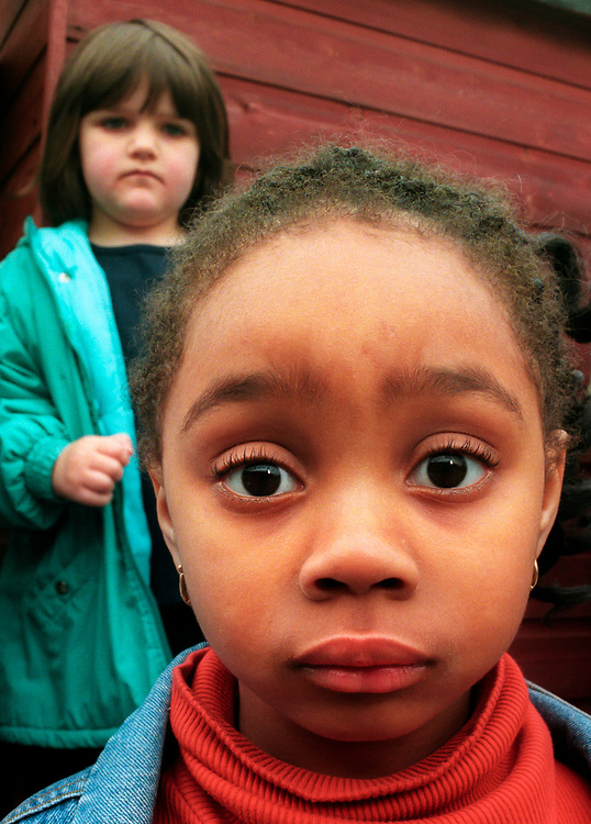 Young black girl in school yard.