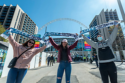 © Licensed to London News Pictures. 25/04/2021. LONDON, UK.  Fans arrive at Wembley Stadium for the Carabao Cup final between Manchester City and Tottenham Hotspur.   8,000 spectators, comprising fans from both teams, NHS workers and local residents will watch the match which is an official test event for the UK Government's Events Research Programme.  Data will be collected for managing and mitigating Covid-19 transmission so that venues can prepare to accommodate fuller crowds and audiences as lockdown restrictions are eased.  Photo credit: Stephen Chung/LNP