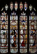 Sixteenth century stained glass windows inside church of Saint Mary, Fairford, Gloucestershire, England, UK - window 11 Saints Thomas, James the minor, Philip, Bartholomew