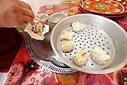 Uzbekistan, Samarqand.<br /> Registan restaurant. Preparation of Manty (steamed dumplings).
