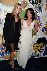 Left to right, KIM HERSOV and TRISH SIMONON at the Hoping Foundation's 'Rock On' Benefit Evening for Palestinian refuge children held at the Cafe de Paris, London on 20th June 2013.