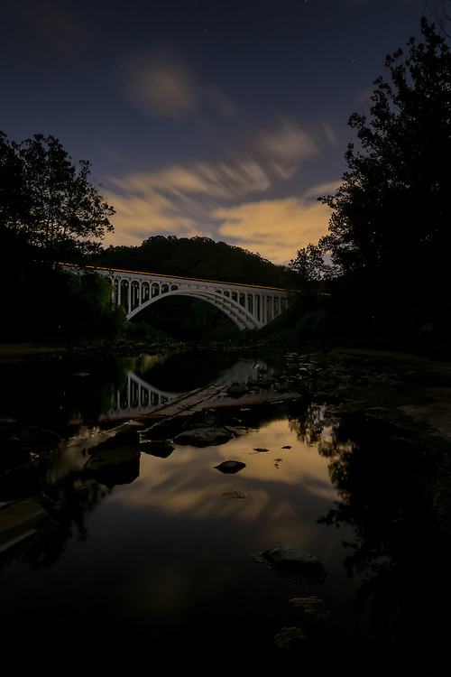 Route 40 bridge in Catonsville, Maryland shot at dawn. The Patapsco River is foreground. Shot on a Fuji X-Pro2.