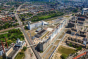Nederland, Noord-Brabant, Eindhoven, 27-05-2013; Strijp-S, voormalige Philipsterrein, was niet toegankelijk voor het publiek, 'de verboden stad'. Het gebied, met diverse Rijksmonumenten, wordt ontwikkeld voor wonen, werken en cultuur.<br /> Boven in beeld Philitefabriek met Klokgebouw (Strijp S), in het midden het Veemgebouw met daar direct naast De Hoge (Witte) Rug. Rechtsonder in beeld, in baksteen het voormalige NatLab. <br /> <br /> Strijp-S, former Philips area, was not accessible to the public, 'the forbidden city'. The area, with several national monuments, is designated for living, working and culture.<br /> Top image Philitefabriek / Clock Building (Strijp S), in the middle of the Veemgebouw next to the High (White) Back. Bottomright in the former NatLab (brick building). <br /> <br /> luchtfoto (toeslag op standard tarieven);<br /> aerial photo (additional fee required);<br /> copyright foto/photo Siebe Swart