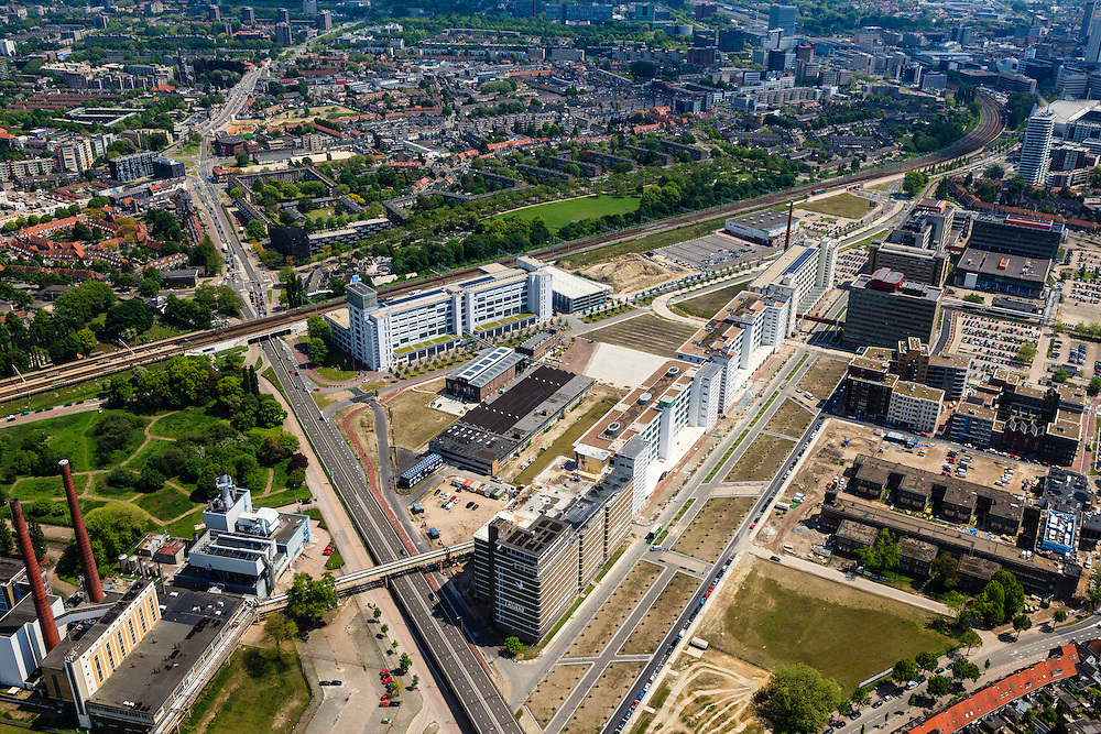 Nederland, Noord-Brabant, Eindhoven, 27-05-2013; Strijp-S, voormalige Philipsterrein, was niet toegankelijk voor het publiek, 'de verboden stad'. Het gebied, met diverse Rijksmonumenten, wordt ontwikkeld voor wonen, werken en cultuur.<br /> Boven in beeld Philitefabriek met Klokgebouw (Strijp S), in het midden het Veemgebouw met daar direct naast De Hoge (Witte) Rug. Rechtsonder in beeld, in baksteen het voormalige NatLab. <br /> <br /> Strijp-S, former Philips area, was not accessible to the public, 'the forbidden city'. The area, with several national monuments, is designated for living, working and culture.<br /> Top image Philitefabriek / Clock Building (Strijp S), in the middle of the Veemgebouw next to the High (White) Back. Bottomright in the former NatLab (brick building). <br /> <br /> luchtfoto (toeslag op standard tarieven);<br /> aerial photo (additional fee required);<br /> copyright foto/photo Siebe Swart