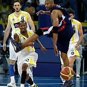 Fenerbahce Ulker's Tarence Anthony KINSEY (L), Semih ERDEN (B) and Efes Pilsen's Charles SMITH (R) during their Turkish Basketball league Play Off Final Sixth Leg match Fenerbahce Ulker between Efes Pilsen at the Abdi Ipekci Arena in Istanbul Turkey on Wednesday 02 June 2010. Photo by Aykut AKICI/TURKPIX