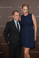 Actress Uma Thurman and Michael Burke, CEO of Louis Vuitton prior to the Louis Vuitton Maison opening, Munich, Germany, on April 23, 2013, April 24, 2013. Photo by: Schneider-Press / i-Images. .UK & USA ONLY. .