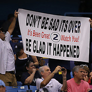 Fans hold a sign up for New York Yankees shortstop Derek Jeter prior to a major league baseball game between the New York Yankees and the Tampa Bay Rays at Tropicana Field on Thursday, Sept. 17, 2014 in St. Petersburg, Florida. (AP Photo/Alex Menendez)
