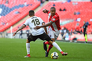 Glenn Walker of Brackley Town (7) and George Porter of Bromley FC (18) battle for the ball during the FA Trophy match between Brackley Town and Bromley at Wembley Stadium, London, England on 20 May 2018. Picture by Stephen Wright.