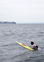 © Licensed to London News Pictures. English Channel. UK 27/07/2011.Toby Lowe pictured. Surf Relief UK paddlers Dave Manley, Nick Thorn, Phil Williams and Toby Lowe paddle surf boards across the 22 miles of the English Channel from Shakespeare Beach, Dover to Cap Gris Nez in France yesterday (26/07/2011). The team smashed their previous predicted 6 hour time, crossing in 5 hours 20 minutes. The team will raise more than £3000 for Surf Relief UK which provides surfing lessoms for disabled and disadvantaged children across the UK. Photo credit: Manu Palomeque/LNP