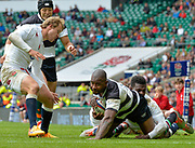 Barbarians wing Ugo Monye (Harlequins & England) is tackled by England wing Christian Wade (Wasps) close to the line during the International Rugby Union match England XV -V- Barbarians at Twickenham Stadium, London, Greater London, England on May  31  2015. (Steve Flynn/Image of Sport)