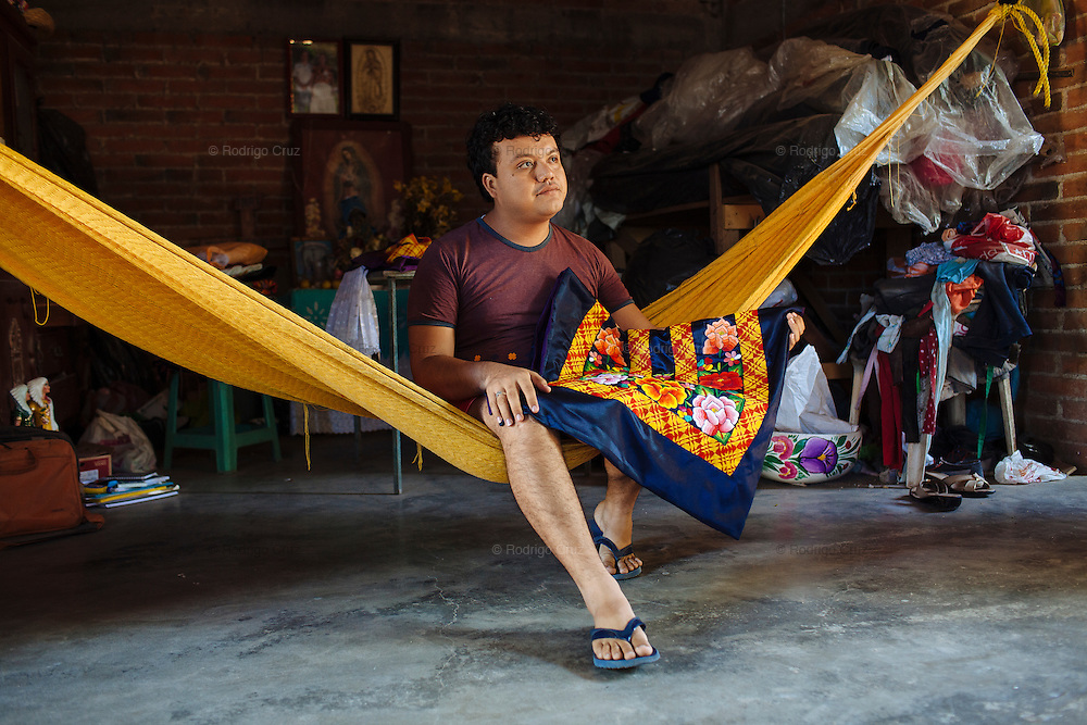 """Angelo Martinez Linares, 24, in Juchitán, Mexico.<br /> <br /> In Juchitán in the southern state of Oaxaca, Mexico, the world is not divided simply into gay and straight, the locals make room for a third category, whom they call """"muxes"""".<br /> <br /> Muxes are men who consider themselves women and live in a socially sanctioned netherworld between the two genders. """"Muxe"""" is a Zapotec word derived from the Spanish """"mujer"""" or woman; it is reserved for males who, from boyhood, have felt themselves drawn to living as a woman, anticipating roles set out for them by the community.<br /> <br /> They are considered hard workers that will forever stay by their mothers side, taking care for their families operating as mothers without children of their own.<br /> <br /> Not all muxes express they identities the same way. Some dress as women and take hormones to change their bodies. Others favor male clothes. What they share is that the community accepts them."""