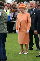 HM THE QUEEN at the 2004 Cartier International polo day at Guards Polo Club, Windsor Great Park, Berkshire on 25th July 2004.