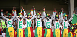 Senegal fans with the team name painted on their bodies during the game