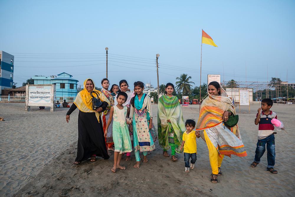 A Bangladeshi family walks onto the beach at Cox's Bazar, Bangladesh (October 25, 2017)