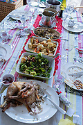 A table of food leftovers, the remains of Christmas excess on Christmas Day, on 25th December 2020 in London, England.Christmas lunch or dinner in the UK is the main meal during the December Christian celebration, when families traditionally come together for the high-protein turkey and high-fibre vegetables - one of the most nutritious meals of the year.