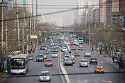 Fulbright fellow Joel Eisen in Beijing. Traffic in the San Li Tun areaof Beijing.