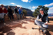 Michael Buchheit explains the canyon's natural history, Grand Canyon National Park, Arizona..Subject photograph(s) are copyright Edward McCain. All rights are reserved except those specifically granted by Edward McCain in writing prior to publication...McCain Photography.211 S 4th Avenue.Tucson, AZ 85701-2103.(520) 623-1998.mobile: (520) 990-0999.fax: (520) 623-1190.http://www.mccainphoto.com.edward@mccainphoto.com..