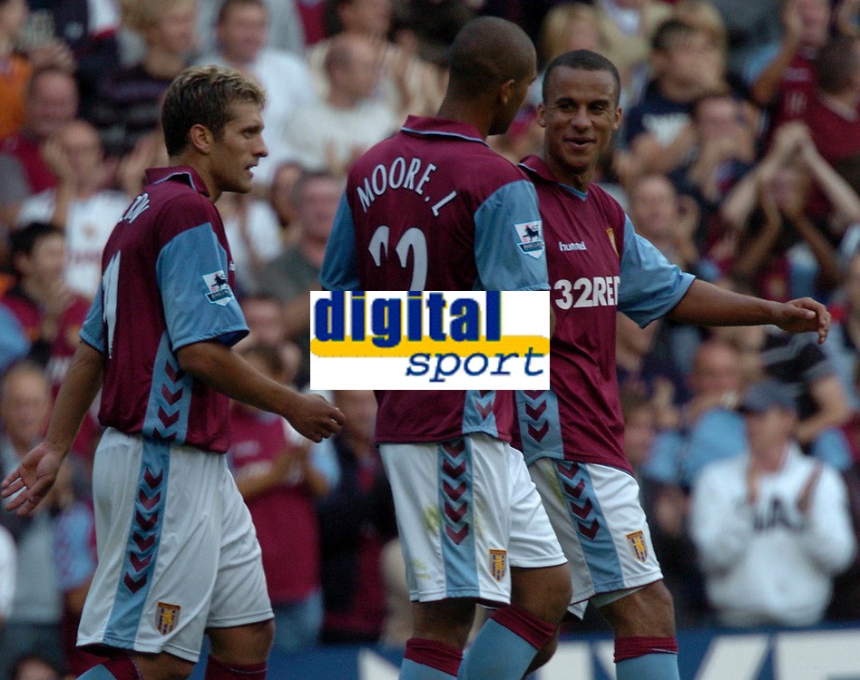 Photo: Ian Hebden.<br />Aston Villa v Charlton Athletic. The Barclays Premiership. 23/09/2006.<br />Villa's Luke Moore (C) is congratulated by team mates after his goal.