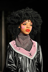 © Licensed to London News Pictures. 16/02/2018. LONDON, UK. A model presents a look by Pam Hogg at Fashion Scout AW18, part of London Fashion Week, taking place at Freemasons Hall in Covent Garden.  Photo credit: Stephen Chung/LNP