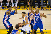 Golden State Warriors guard Stephen Curry (30) is surrounded by the Philadelphia 76ers defense during a drive at Oracle Arena in Oakland, Calif., on March 14, 2017. (Stan Olszewski/Special to S.F. Examiner)