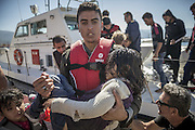 Oct. 15, 2015 - Lesbos Island, Greece - <br /> <br /> European Migrant Crisis<br /> <br /> Refugees and Migrants arrive in the Molyvos port, after Greek coastguard vessel hits migrant boat on the Greek Island of Lesbos. More than 400,000 refugees, mostly Syrians and Afghans, arrived in Greece since early January while dozens were drowned trying to make the crossing. In total 710,000 have entered the EU through Greece and Italy during the same period, according to the European Agency Frontex border surveillance. <br /> ©Exclusivepix Media