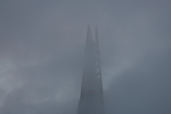 © Licensed to London News Pictures. 07/01/2017. LONDON, UK.  The top of the London Shard is shrouded in mist and fog this morning. The weather in London today is misty, foggy and much milder than it has been during the past week.  Photo credit: Vickie Flores/LNP