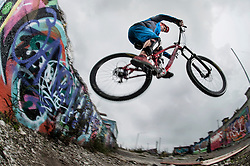Mountain biker stunts on road, Bavaria, Germany