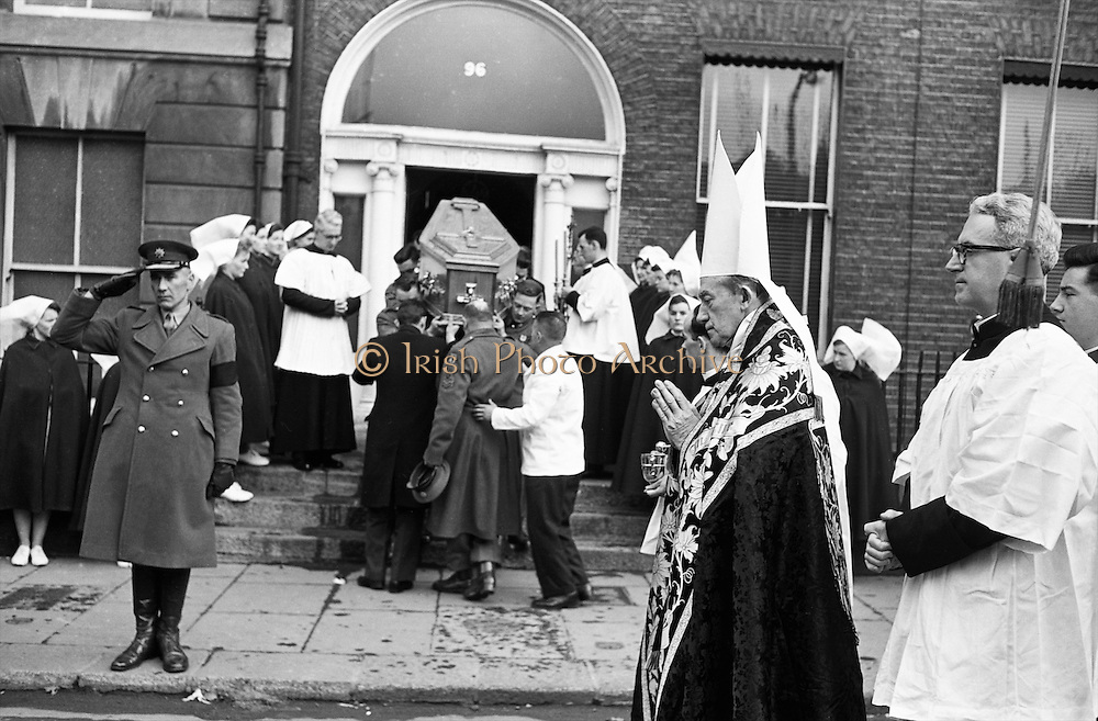 The remains of Cardinal D'Alton leave St Vincent's Nursing Home, Dublin, borne by members of  the defence forces. Dr John Charles Mc Quaid, Archbishop of Dublin (in mitre), blessed  the coffin as it was taken to the hearse. The cardinal was buried in St Patrick's Cathedral, Armagh. .02.02.1963