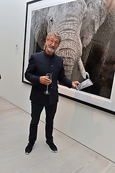 EDDIE JORDAN at a private view of photographs by wildlife photographer David Yarrow included in his book 'Encounter' held at The Saatchi Gallery, Duke of York's HQ, King's Road, London on 13th November 2013.