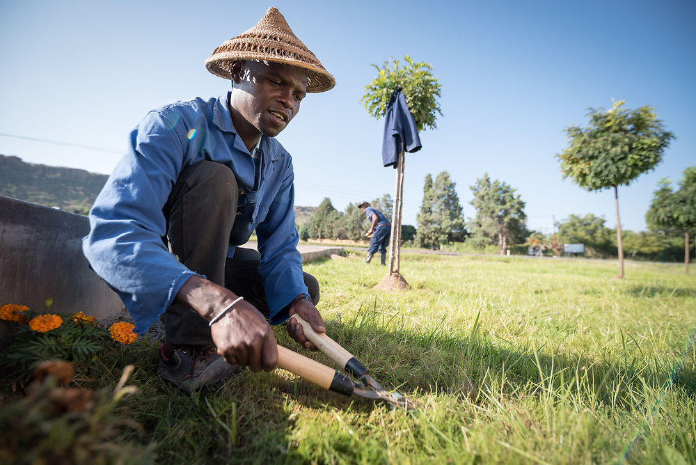 2 March 2017, Thaba Bosiu, Lesotho: Gardener at the Goodnight Lodge in the village of Thaba Bosiu, Lesotho. He is wearing a tsetse, a traditional hat commonly used in Lesotho. Thaba Bosiu is a sandstone plateau some 24 kilometers east of Lesotho's capital, Maseru. The name means Night Mountain, and surrounding the plateau is a small village and open plains. Thaba Bosiu was once the capital of Lesotho, and the mountain was the stronghold of the Basotho king when the kingdom of Lesotho was formed.