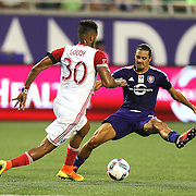 ORLANDO, FL - JUNE 18:  Anibal Godoy #30 of San Jose Earthquakes runs past a leaping Adrian Winter #32 of Orlando City SC during an MLS soccer match between the San Jose Earthquakes and the Orlando City SC at Camping World Stadium on June 18, 2016 in Orlando, Florida. (Photo by Alex Menendez/Getty Images) *** Local Caption *** Anibal Godoy; Adrian Winter