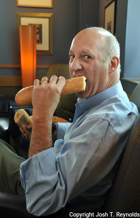 6/30/2009 3:07:39 PM -- Needham, MA, U.S.A.. -- CEO Profile - Panera CEO Ron Shaich (cq) eats a French baguette at a Franchise-owned Panera Bread cafe in Needham. --  Photo by Josh T. Reynolds, Freelance..****Yes, it was Shaich's suggestion; yes he actually ate a significant portion of that loaf.-jr***..