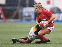 Wales Alecs Donovan tackled by South Africa Snenhlanhla Shozi<br /> <br /> Wales Women v South Africa Women<br /> Autumn International<br /> <br /> Photographer Mike Jones / Replay Images<br /> Cardiff Arms Park<br /> 10th November 2018<br /> <br /> World Copyright © 2018 Replay Images. All rights reserved. info@replayimages.co.uk - http://replayimages.co.uk