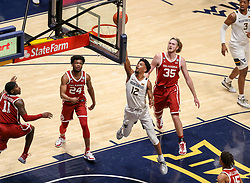 Feb 13, 2021; Morgantown, West Virginia, USA; West Virginia Mountaineers guard Taz Sherman (12) shoots in the lane during the second half against the Oklahoma Sooners at WVU Coliseum. Mandatory Credit: Ben Queen-USA TODAY Sports