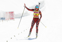 BERGER Tora of Norway celebrates at finish area during Women 10 km Pursuit competition of the e.on IBU Biathlon World Cup on Saturday, March 8, 2014 in Pokljuka, Slovenia. Photo by Vid Ponikvar / Sportida