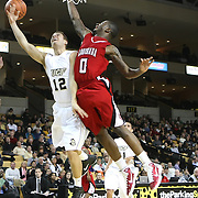 Central Florida guard Taylor Young (12) drives to the basket against Louisiana's forward Bryant Mbamalu (0) during their game at the UCF Arena on December 15, 2010 in Orlando, Florida. UCF won the game79-58. (AP Photo/Alex Menendez)